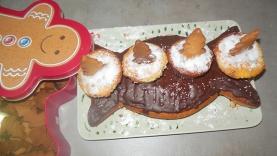 Friandises de Noël sur son coussin de bonbon nappé de chocolat