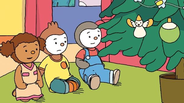 Pilou ,  T'choupi et Lalou devant le sapin de Noël.