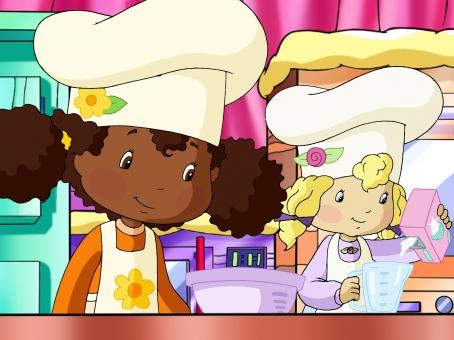 Angélique et son amie Fleur d'Oranger lisent une recette de gâteau aux pommes