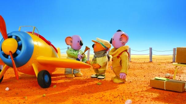 Ned et les Frères Koalas devant leur avion