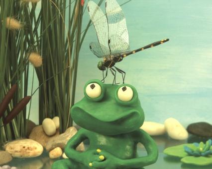 Reinette avec une libellule sur la tête